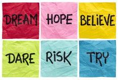 Dream, believe, risk, try. Dream, hope, believe, dare, risk, try - motivational concept - a set of isolated crumpled sticky notes with handwritten advice and royalty free stock photos