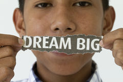 Dream big. Abstract with teen holding a newspaper cutout Stock Photography
