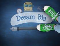Dream big against blue chalkboard Royalty Free Stock Photos