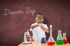 Dream big against desk Stock Photo