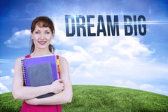 Dream big against green hill under blue sky Royalty Free Stock Image