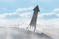 Dream big against road turning into arrow Royalty Free Stock Photo