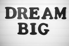 Dream Big in black on white board. Dream Big phraze in black capital letters on white painted wood pallet stock photography