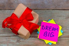 Dream big and gift box  concept - motivational advice or reminde Royalty Free Stock Photography