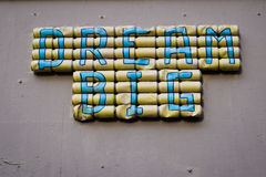 Dream big. Dream big letters written on a group of cans Stock Images