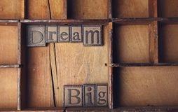 Dream Big in Letterstock. Close up of the words Dream Big in wooden letterpress Stock Photo
