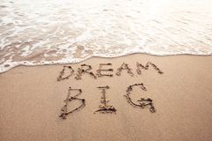 Dream big, motivational sign. On the sand of beach Royalty Free Stock Image