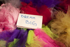 Dream big. Notepad on a pile of tulle royalty free stock image