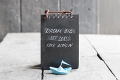 Dream big, set goals, take action on blackboard written Stock Image