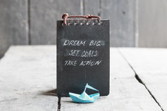 Dream big, set goals, take action on blackboard written, start up idea Royalty Free Stock Image