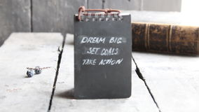 Dream Big Set Goals Take Action, Inspirational motivation quote. Dream Big Set Goals Take Action, vintage style, label and old book stock footage