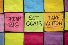 Dream big, set goals, take action on sticky notes Royalty Free Stock Images