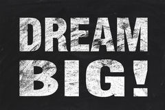 Dream big. Text is written by white chalk on blackboard Stock Images