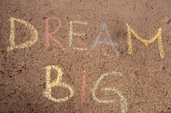 Dream big. Written with chalk stock image