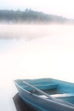 Dream Boat. A row boat sits peacefully on shore Stock Photo