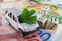 Dream car. Silver car with lucky clover, dice and Euro notes Royalty Free Stock Photo