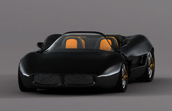 Dream Car. Home made black convertible sports car on a neutral grey background. Seen from front Royalty Free Stock Images