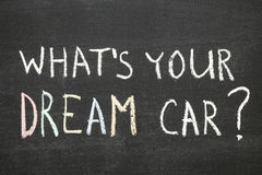 Dream car. What's your dream car? phrase handwritten on chalkboard by color chalk Stock Photos