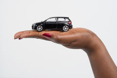 Dream Car in your hands. Hand holding a dream car Stock Images