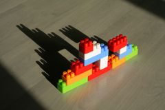 Dream castle. Children's toy building blocks casting a shadow of a castle on the floor (clipping path royalty free stock photography