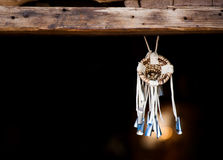 Dream Catcher. Native American Dream Catcher Suspended from Wooden Beam royalty free stock images
