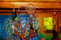Dream catcher in beautiful interior in background. Royalty Free Stock Image