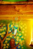 Dream catcher in beautiful interior in background. Stock Photos