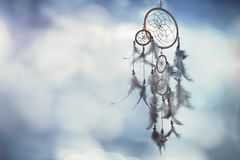 Dream catcher on blue background with copy space royalty free stock images