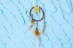 Dream catcher. On Blue wall royalty free stock photo