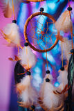 Dream catcher on the bright multicolored background Royalty Free Stock Photos