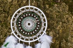 Handmade dream catcher with feathers threads and beads rope hanging. Dream catcher with feathers threads and beads rope hanging. Dreamcatcher handmade Stock Images