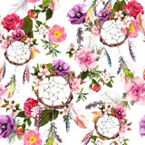 Dream catcher, flowers, feathers. Seamless pattern. Watercolor. Dream catcher, flowers, feathers. Seamless pattern Watercolor floral background Stock Photo