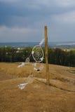 Dream catcher hanging  in a dry field. Dream catcher hanging  in a dry land Royalty Free Stock Photo