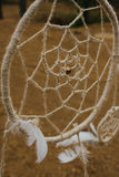 Dream catcher hanging  in a dry land. Dream catcher hanging in a dry land Stock Photos