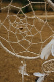 Dream catcher hanging  in a dry land.  Royalty Free Stock Photos