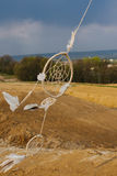 Dream catcher hanging  in a dry land Royalty Free Stock Photos