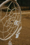 Dream catcher hanging  in a dry land Royalty Free Stock Photography