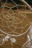 Dream catcher hanging  in a dry land.  Stock Photos