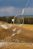 Dream catcher hanging  in a dry land.  Stock Photography