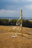 Dream catcher hanging  in a dry land. Dream catcher hanging  in a dry field Royalty Free Stock Photography