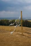 Dream catcher hanging  in a dry land. Dream catcher hanging  in a dry field Stock Photo