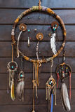 Dream catcher. Hanging on a wooden wall Stock Image