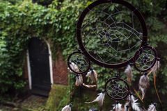 Dream catcher with one door in the brick wall and green trees Stock Photo