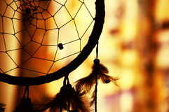 Dream catcher silhouette. Native american dream catcher in silhouette against a warm background Stock Photography