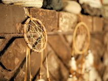 Dream catchers with feathers on brick background. stock photography