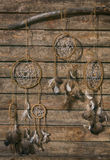 Dream catchers hanging on a wooden wall Stock Photo