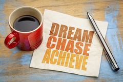 Dream, chase, achieve word abstract. Dream, chase, achieve - inspiraitonal word abstract on a napkin with a cup of coffee Royalty Free Stock Photo