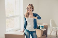 Dream come true! Young woman with beaming smile showing thumb up royalty free stock images