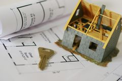 Dream comes true. A new miniature construction house on plan with a key stock image