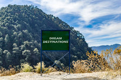 Dream destinations. Text message on the board Royalty Free Stock Photos
